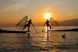 traditional fishermen during the sunset at inle lake myanmar