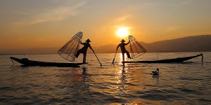 traditional fishermen during the sunset at inle lake myanmar