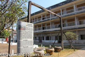 the perch with tombs in the backgroud, Tuol Sleng Genocide Museum