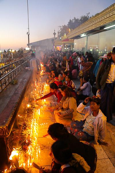 Myanmar, faithful praying at the Golden Rock