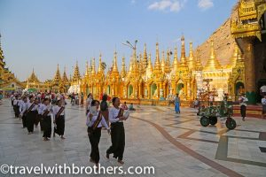 Yangon, young faithful at the Shwedagon Pagoda