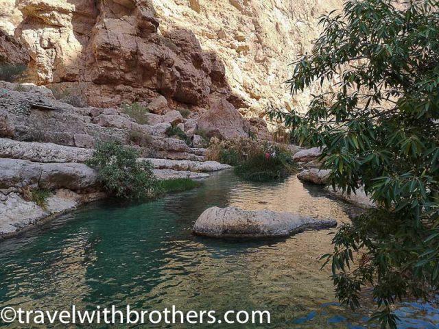 a natural pool in the Wadi Shab, Oman