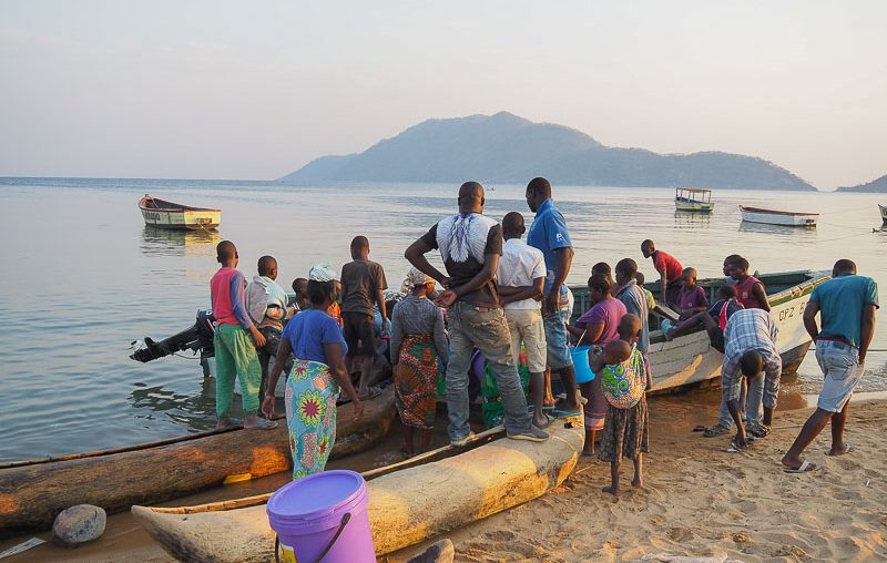 Locals waiting for the fishermen boats, Lake Malawi NP