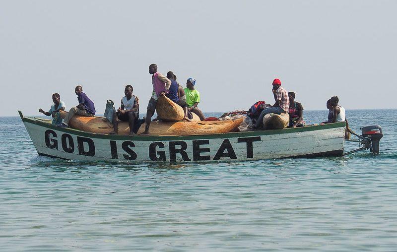 Fishermen returning from nigh fishing, Lake Malawi NP