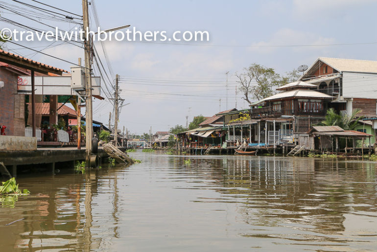 Thailand, stilt houses along the canal close to Amphawa market