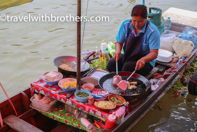 Thailand, boat vendor at Amphawa floating market